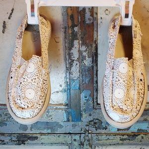Sanuk slip on cream colored shoes